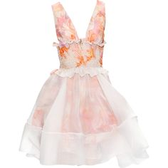 This sweet little dress makes is a new take on a summer frock. The smock of the dress is adorable and girls and the white layer of fabric over the skirt makes the dress fancy.