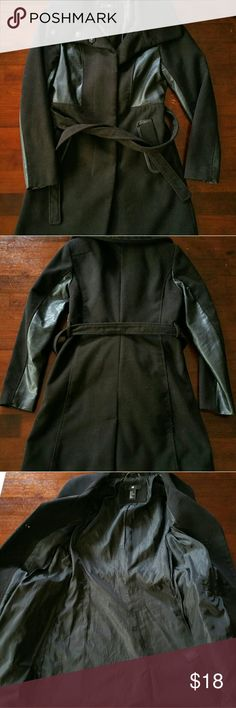 """H&M Faux Leather Accented Coat Absolutely loved this coat but it's time to make room for a different one (woes of living in a small apartment!) Features an exaggerated collar (can be buttoned up to the neck for extra warmth), faux leather sleeves, button closures, pockets, & a detachable belt. Length is 35"""", bust is 18.5"""", waist is 16.25"""", shoulder to shoulder in the back is 15.5"""". Belt has a total length of 72 inches. Looks super flattering on and is a great winter staple! Aka it helped me…"""