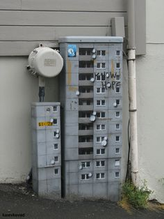 Electrical box made to look like an apartment building, complete with satellite dishes! Cool!