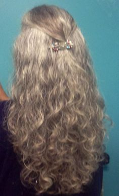 Long gray hair. I love this so much!  Beauty is at every age, and we can embrace God's gifts. A wife's long hair is just naturally beautiful, a glory to her and a joy to her partner/husband. Quit trying the artificial route and trust in how you were made.