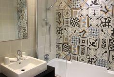 Cool mosaic tile bathroom at Hotel Square Louvois Paris