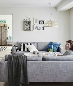 Add plenty of throws and cushions to make your home feel extra cosy through the winter months | Gina's house in Norway #IKEAFAMILYMAGAZINE