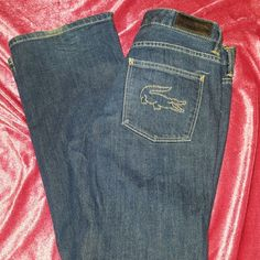 LACOSTE Boot Cut Jeans size 26 Gator Stitch Size ladies 26 ~ 98% cotton 2% elastane ~  wore a handful of times in great condition. Only a small wear at heel as shown. Lacoste Jeans Boot Cut