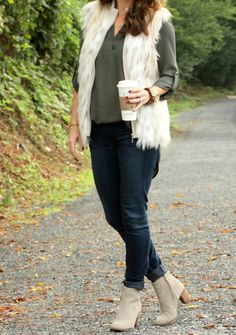 Perfect outfit for a perfect fall day.  Olive tunic top, faux fur vest, denim and booties on Peaches In A Pod blog.