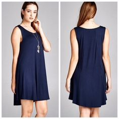 Navy Sleeveless Tunic Dress Don't think any closet should be without this dress! Solid, scoop neck, sleeveless tunic dress featuring an A-Line silhouette & reverse stitching on back panel. Unlined. Non sheer. Lightweight. 95% Rayon 5% Spandex. Dresses Midi