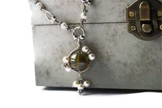 Oxidized silver wire wrap pearl and olive green by DoodleDaisy, £12.00