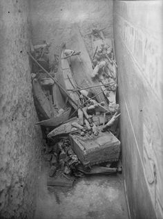 THIS IS WHERE THEY FOUND THE COFFIN OF DJEHUTINAKHT - Pile of models and other objects in situ, found between the east wall of tomb and the outer coffin of Governor Djehutinakht. 1915