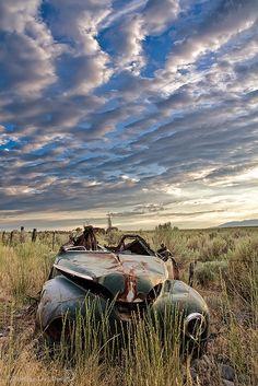 Abandoned old car put out to pasture, Great Salt Lake, Utah