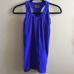 Athleta tank with shelf bra small Super cute and comfy! Comes with a shelf bra for extra support. Excellent condition and great quality Athleta Tops Tank Tops