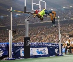 Qatari high-jumper Mutaz Essa Barshim clears the bar at 2.43 metres - draws comparisons with height of a basketball hoop