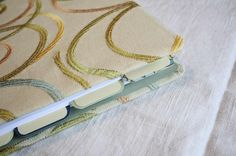 The Creative Place: DIY Tuesday :: Fabric Covered Binder ~ Cover a cheap binder with fabric!