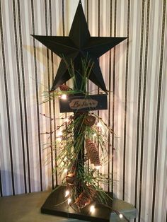 Lighted Primitive Christmas tree.  Check out my Facebook page - Primitive Panes for all my products!