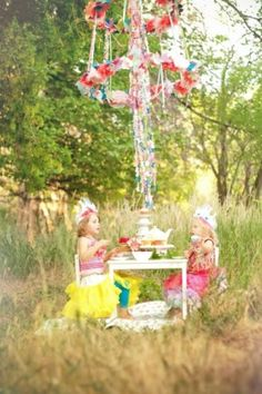 Little kids having a tea party outdoors, adorable.