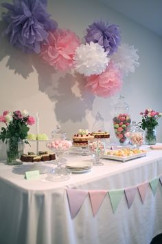 purple and green baby shower decorations. Our girly pink  purple and green themed baby shower dessert table candy buffet Decorations included handmade tissue paper pom poms bunting as well Ok this is supposed to be for a Baby Shower but I totally want