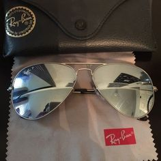 Comes with the essential kit as seen in picture. Are used but in good condition. I'd like to say 5 months I've had them and used them not so often. No major scratches on lenses. Purchased from Macy's! 100% Authentic Ray-Ban sunglasses. Price is firm. These are the silver mirror ones. Let me know if you want more pictures :)