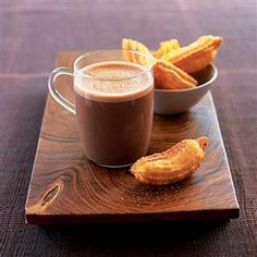 Hot chocolate with churros recipe. Churros are sweet doughy snacks that originate from Spain. These treats are fried then dipped in rich hot chocolate – very nice and a little bit naughty.