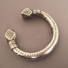 Silver, Morocco,Egypt, Sudan, Sahara  Description    This bracelet Berber found in Middle Atlas is a bracelet of the first half of the 20th century ... These bracelets quite wearable but heavy enough have as a certain value because of their weight of silver for the women who wore them... this type bracelet is also found in Nubia and often as anklets, Sudan and even in sub-Saharan Africa (Mali, Niger).  Weight:217,6gr  diameter:Int : 2,55inch
