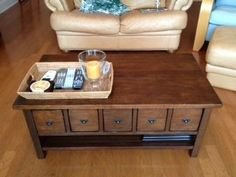 pottery barn coffee table with drawers that pull open from either side
