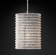 """RH's Crystal Halo Pendant 12"""" - Clear Glass:Our pendant echoes the ingenious design of a stunning antique French chandelier from the 1930s. Hundreds of faceted, hand-wrapped crystal glass beads wrap the steel frame to form a glowing cylinder of refracted light.SHOP THE ENTIRE COLLECTION ▸"""