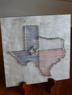 Nail, thread, and wood Texas art on Curiously Wrought's Etsy page