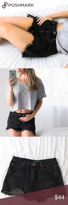 """🆕North Haven Denim Shorts ◽️High waist vintage faded black denim shorts with the perfect fit and laid back look!🐚 Destroyed wash and unique style. Side slit for added comfort. 100% cotton. I am modeling Size M and wear a 26/27 in jeans. New. Medium waist across is 14.5"""" with an 11"""" rise. Complete the look with my Peconic Crop Top.  ▫️Price is firm, no offers 📷 Photos are my own 11thstreet Shorts Jean Shorts"""