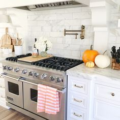 White marble kitchen with large Viking stove