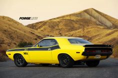 The E-Max Dodge Challenger by Hotchkis Sport Suspension is no pro-touring pretty boy. This thing is bad to the bone. And it rolls on 18-inch Forgeline ZX3R wheels.