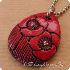 red poppy necklace made from polymer clay