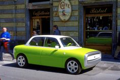 lime green & white car . Ford 021C