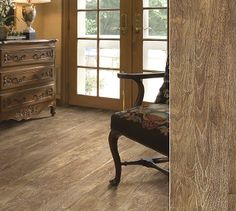 """Shaw laminate in a """"limed"""" visual combining traditional and modern. Style Breton in color Truffle."""
