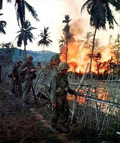 A Vietnamese village burns after US Marines conducting a search and a destroy mission