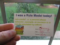 Really cool idea! Pass out role model cards to students doing exceptionally well. Their parents sign it and return it to school. After a given period of time you can pull from the cards for a large or extra prize. You could even make a role model board.