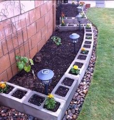 Garden edging is a fixed material that functions as a crisp border between beds and other areas. Various stylish garden edging ideas are available to build a well-designed landscape. Backyard Vegetable Gardens, Vegetable Garden Design, Gardening Vegetables, Garden Oasis, Terrace Garden, Vegetable Bed, Cinder Block Garden, Cinder Blocks, Cinder Block Ideas