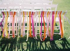 Simple white chairs are turned into fanciful seats when strung with ribbons in a rainbow of hues. #chair  Photography: Kurt Boomer Photo - kurtboomerphoto.com  Read More: http://www.stylemepretty.com/2014/01/31/carmel-by-the-sea-wedding-at-mission-ranch-hotel/