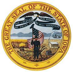 """The Great Seal of the State of Iowa was created in 1847 and depicts a citizen soldier standing in a wheat field surrounded by symbols important in early historical Iowa, including farming, mining, and transportation with the Mississippi River in the background. An eagle overhead bears the state motto, """"Our liberties we prize and our rights we will maintain."""""""