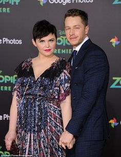 Work place romance: Josh - who married Ginnifer in 2014, after they met on the set of Once Upon A Time - looked smart in a dark blue suit