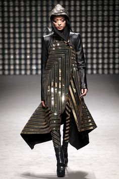 Fei Fei Sun at Gareth Pugh F/W 2011-12. fierce metallic fashion - Gown? Suit? don't know... just think it's kinda cool. Different.