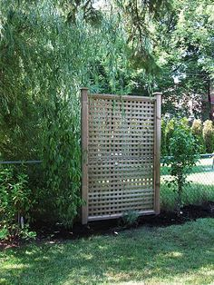 """Aubrey finished thethree privacy screens in our backyard today. Yippee!One is in the very far left (hard to see), one the middle, and one closest to us in the photo. They are evenly spaced through the garden. This actually concludes all projects in the yard, except for landscaping with plants or adding in other """"pre-bought"""" items. No more building in the garden.  >To recap, we wanted tobuild these privacy screens in our backyard for the following reasons (a) to hide the chain link…"""