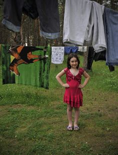 A Chechen girl looks at her family's laundry while staying in a reception centre in Linin, Poland. © UNHCR/B. Szandelszky/2010