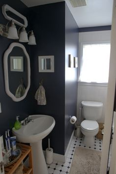 Navy bathroom with pedestal sink for family bath...now think we may do this to enlarge the space.