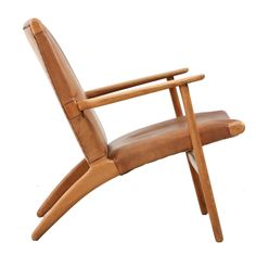 Model Ch-25 Hans Wegner Lounge Chair in Leather | See more antique and modern Armchairs at http://www.1stdibs.com/furniture/seating/armchairs