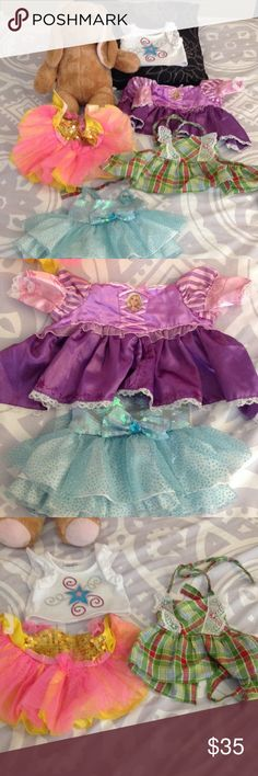 Build a bear Bunny with 5 pieces! This is a lot of one Build A bear bunny and 5 pieces of clothing including a Rapunzel dress, Frozen inspired tutu dress, a shirt, an apron and beautiful yellow and pink tutu. Great condition Build A Bear Other