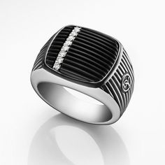 The classic signet ring in a bold, new design with scored black onyx accented with pavé diamonds.