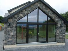 External stone cladding gallery showing examples of Century Stone products on exterior walling. Stone Cladding Exterior, Stone Exterior Houses, House Cladding, Stone Houses, Modern Bungalow Exterior, Bungalow House Design, House Designs Ireland, Bungalow Extensions, Self Build Houses