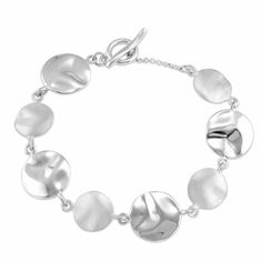 Organic Circle Link Bracelet in Sterling Silver The Black Bow. $367.00. Satin and polished hammered design. Average weight 13.06grams. 8-inch bracelet with toggle clasp. Crafted from sterling silver