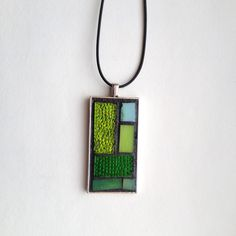"Gorgeous color block style green stained glass mosaic pendant. Silver-plated base with 18"" waxed cotton cord. Hand created by NiagaraGlassMosaics on Etsy"