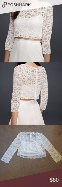 David's Bridal White Lace Crop Top Worn once for my rehearsal dinner. Soft White color. Back zipper. Dry clean only. Perfect for any wedding event. David's Bridal Tops Crop Tops