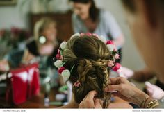 Plaits and flowers make for a beautiful bridal style | A Family Affair in the French Countryside | Photograph by Trois Studios Photographie | Real weddings