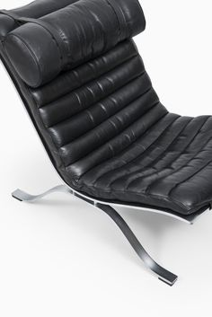 Arne Norell Ari easy chairs in matt chromed steel and black leather produced by Arne Norell AB in Sweden. Available at Studio Schalling