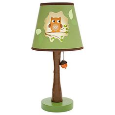 Transform your nursery into a forest full of animal friends with the Woodland Tales Bedding Collection from Lambs & Ivy. This Lamp Base and Shade has a tree-shaped stem, acorn pull chain, and cute owl on the shade.